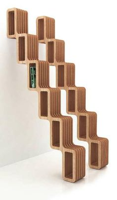 This modern bookshelf is called Quetza and draws its inspiration from Aztec history. The stair-step design marches up the wall much like a pyramid. Unique Bookshelves, Modern Bookshelf, Simple Bookshelf, Bookshelf Ideas, Bookcase Stairs, Open Bookcase, Bookcases, Furniture Making, Home Furniture