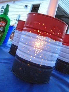 Keep the lights on after the sun goes down on your 4th of July cookout with these tin can luminaries.  Paint a clean, empty tin can red, white, and blue.  Carefully punch a fireworks design through the can.  Toss a tea candle in the bottom, and you're ready to go!