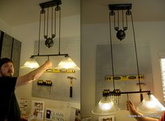 Adjustable light fixture for a workstation.  LOVE the pulleys.