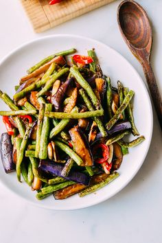 Eggplant String Bean Stir-fry Recipe - The Woks of Life This Chinese eggplant string bean stir-fry is an easy, delicious dish with only 10 ingredients, most of which you probably already have in your pantry. Stir Fry Dishes, Stir Fry Recipes, Cooking Recipes, Cooking Games, Yummy Vegetable Recipes, Vegetarian Recipes, Healthy Recipes, Vegetable Dish, Clean Eating