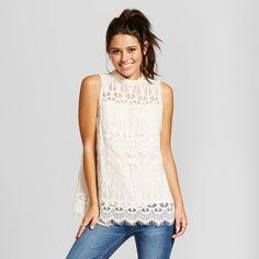 A top that will get you through work-to-weekend and everything in between, the Lace Mockneck Tank from Xhilaration™ will soon become your new go-to closet grab. The high-neck lace tank makes for an elegant and feminine style that's perfect for every occasion. Pair this tank with a blazer for a day at the office, then slip into skinny jeans and heels for the perfect date night look.