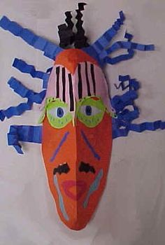 African Paper Masks- Art and Social Studies Integrated Lesson Plan (The paper is held vertically and then the center top and bottom is cut in about 1 ½ to 2 inches. The cut section is pulled together and glued. African Art Projects, 2nd Grade Art, Grade 2, Ecole Art, Masks Art, School Art Projects, Thinking Day, African Masks, Art Lessons Elementary