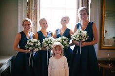 Bridesmaid wear short navy dresses. Photography by http://naomifowlerweddings.com/
