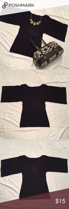 Kimono sleeve sweater Black sweater is fitted at chest and waist with flowy kimono sleeves and boat neckline. Can be dressed up with a statement necklace and heels or dressed down with shorts and sneakers. Forever 21 Sweaters