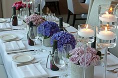Purple Centerpieces with tall Floating Candles