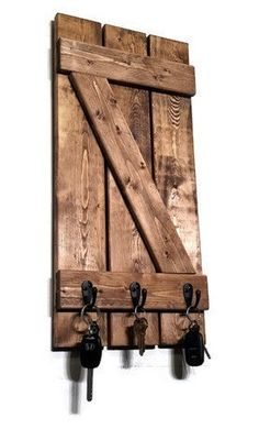 Renewed Décor's miniature shutter key rack features a decorative handmade z-bar style board-n-batten shutter and is built with reclaimed styled solid knotty pine. This key rack is attractive as a deco