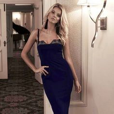 A stunning full length dress by Love Honor. Features a hidden bustier bodice with moulded cups and a delicate lace trimming on the straps and bust. Available in Navy & Champagne. See more here: https://whiterunway.com/dena-gown.html