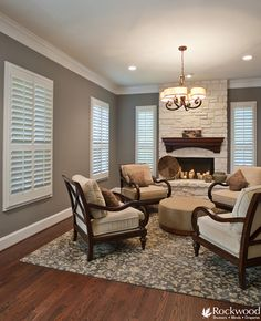 Liteline white plantation shutters in living room with white stone fireplace