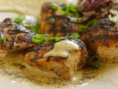 Up your spice count to 16 with Bobby's Sixteen-Spice-Rubbed Chicken Breast with Black Pepper Vinegar Sauce and Green Onion Slaw.