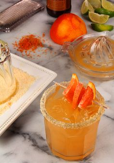 The Elle Yes! Margarita featuring Cara Cara Oranges and Ginger Beer | rim: 1/2c sugar, 2Tbsp Kosher salt, 1tsp orange zest, 1/4c Cara Cara/Blood O.J. - drink: 1 1/2oz Tequila, 2oz fresh Cara Cara/Blood OJ, 1wedge lime, 3oz chilled ginger beer/ale sub. - Mix sugar, salt + orange zest. Dip ea. glass rim in oj, then in dry mix. Combine tequila, oj + lime juice in a shaker with ice, shake well, strain into ice filled glass. Top with chilled ginger beer, orange slice garnish. | Creative Culinary