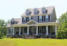 The Swansboro Plan 853 http://www.dongardner.com/plan_details.aspx?pid=2134 - A trio of dormers with arch-topped windows, a splendid oval window, and a wrapping front porch with gable entry create a welcoming facade for this modest and affordable farmhouse. #House #Designs #Country #Small