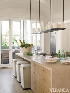 This sleek modern kitchen design by Liz Hand Woods is balanced by warm wood cabinets, leaded-glass pantry doors and limestone countertops. Home Decor Kitchen, Kitchen And Bath, Kitchen Interior, Kitchen Dining, Kitchen Island, Rustic Kitchen, Nice Kitchen, Kitchen Ideas, Island Table