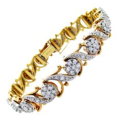 JABEL. Very fine quality and workmanship and extremely well priced 18kt yellow gold Jabel diamond bracelet. Prong and bead set in white gold with 150 round cut diamonds totaling approx. 3.25cts. Ca. 1980s