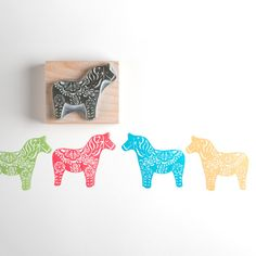 The Dala horse comes from Sweden and were calved by wood cutters in wood cabins during the long winter months as toys for their children. The