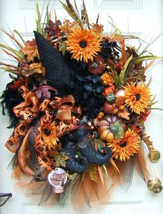 Last one XXL Halloween wreath Primitive witch by WreathsbyKimberly, $175.00... I wonder if i could make a wreath myself.  this is an inspiration.