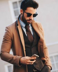 Topcoat, camel coat, brown vest, brown tie, and sunglasses. Sharp Dressed Man, Well Dressed Men, What To Wear Fall, How To Wear, Mode Man, Brown Vest, Brown Tie, Dark Brown, Mens Brown Coat
