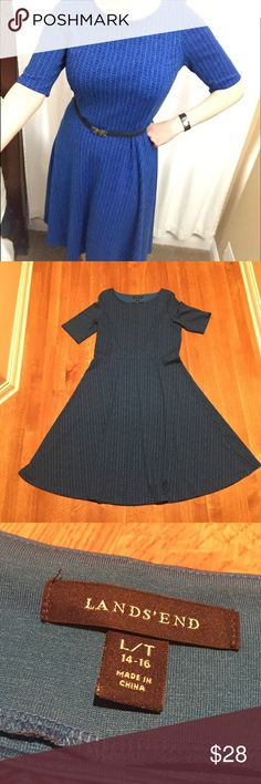 "Lands End TALL blue dress with full skirt Beautiful blue dress with subtle black print. Lovely full skirt. Machine washable with elbow length sleeve. Pair with a belt (not included) or add a blazer or sweater on top. So cute and a generous 45"" from shoulder to hem. Nearly new! Size is Large Tall. Lands' End Dresses Midi"