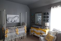 Adore the yellow chevron dresser and other accents in this gray nursery.  #yellow #gray #nursery #chevron
