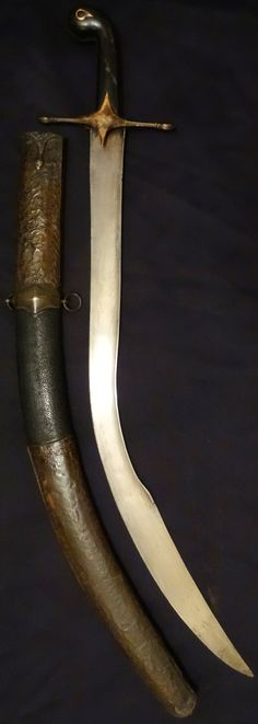 The short version of the Ottoman kilij sometimes known as ''pala'', with deeply curved wide blade and 'T' spine, it was in use from the early 17 C. for more than 300 years well into the 20th C. The hilt of classical form is made of brass cross guard and horn grips with bulbous pommel and brass grip strap. The original wood scabbard is covered with leather and has spiral brass stitching, mounted with chased brass locket and chape, 27 inch blade, 33 inches total.