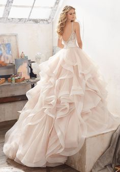 1990f88ebb Dreamy layers of flounced organza trimmed with horsehair all come together  beautifully to create the perfect ...