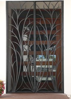 Wrought-iron grass design door