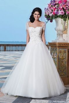 Sincerity - Sloan. Tulle, corded lace, beaded lace ball gown complemented by a sweetheart neckline