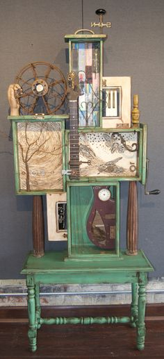 Assemblage--Music Resonates from the Earth...Encaustic, found objects, ink, wire, and oil--Kathy Moore artist--www.kathymooreart.com