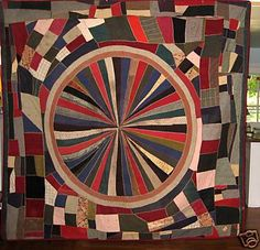 African American wheel of fortune quilt, on eBay.  Such movement and color ~~ adapt for a rug