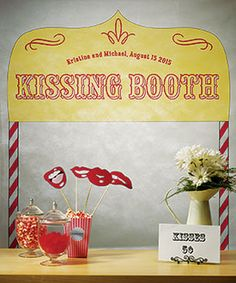 I love the idea of a kissing booth rather than a photo booth... after all a wedding is about love!