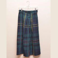 """Vintage Diane Von Furstenberg wool plaid skirt Fantastic vintage Diane Von Furstenberg wool blend skirt. Size 8.  Blue, green, yellow and red plaid pattern. A few pleats. Side button for closure. It has pockets but one of them came unsown but it's an easy fix. Other then that it's in really great shape for a classic vintage piece!   70% wool 30% polyester Waist: 26"""" Hip: 35"""" Length: 29"""" Diane von Furstenberg Skirts A-Line or Full"""