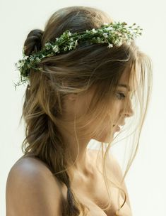 Undone hair meets a garland of fresh flowers.