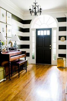 Striped foyer walls: Urbane Bronze + Shoji White by @SherwinWilliams  (black and white entryway)