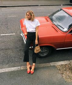 woman leaning in red shoes against bright orange car / sfgirlbybay