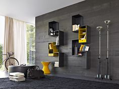 :: STUDIOS :: Image Source: Fortepiano Molteni & C. inspiration image for an interesting wall concept to pair modular shelving with wood panelling & a hit of colour #studios #Molteni