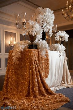 Mounds of cascading white #orchids with luxe gold and cream linens, by Premiere Party Central  #OneWediPad #photooftheday