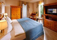 Classic Rooms offer around 20 of floor area and views of Lucerne's pulsing town life. The rooms feature a marble or parquet floor plus a queen size or twin beds. Comfortable Sofa, Parquet Flooring, Empire Style, Grand Hotel, Service Car, Queen Size, Hotel Offers, Guest Room
