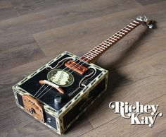 Hey, I found this really awesome Etsy listing at https://www.etsy.com/listing/564448253/richey-kay-3-string-cigar-box-guitar