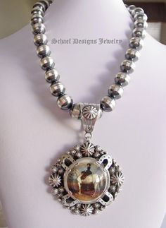 Schaef Designs Lady on Horse Bridle Rosette Pendant on Navajo Pearl necklace