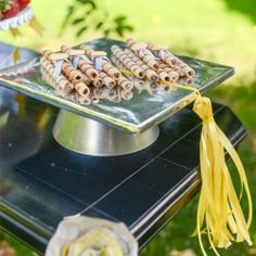 Cake plates always look great on a dessert table; they add height and visual interest. They're even more perfect for a graduation when they'...