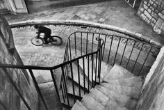 Henri Cartier-Bresson. Hyeres France (1932) Bicycle Blur Spiral Staircase