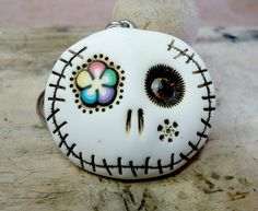 Hey, I found this really awesome Etsy listing at https://www.etsy.com/listing/159557164/white-round-skull-with-a-rainbow-flower