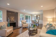 Contemporary Great Room with Chair rail, Signature Design by Ashley DuraBlend-Ivory Leather Sofa, Wainscotting, Crown molding