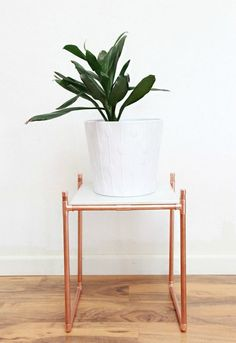 s the 15 coolest ways to reuse pipes in your home decor, Turn copper pipe into a luxurious plant stand