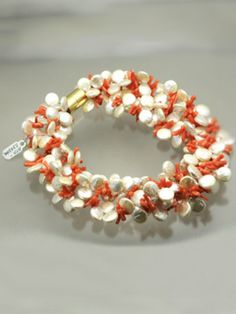 A large torsade of salmon branch coral and freshwater pearls with a vermeil magnetic clasp.  Stk# nck-5343