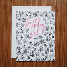 """An eye-catching card for the birthday girl. This design features hand-illustrated flowers inspired by Colorado's summertime wildflowers. """"Birthday Girl"""" is hand-lettered in pink. Available as a single"""