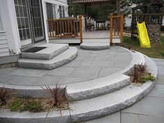 Mahogany guardrails, granite posts, granite steps, and full-color bluestone patio.