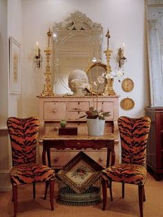 Beautiful chest and mirror - love the animal print chairs mixed in.