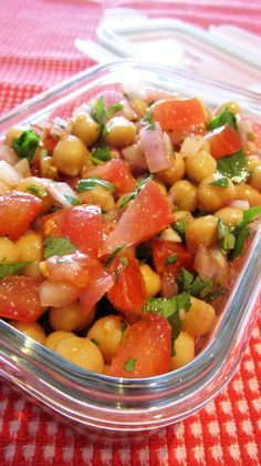 Easy Mexican Chickpea Salad | Vegangela 19oz can chickpeas 1 large tomato, chopped 3 whole green onions, sliced OR ⅓ cup diced red onion ¼ cup finely chopped cilantro (fresh coriander) 1 avocado, diced (optional) 2 tbsp vegetable or olive oil 1 tbsp lemon juice 1 tsp cumin ¼ tsp chili powder ¼ tsp salt