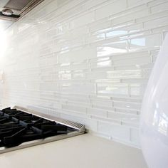 love this glass tile backsplash