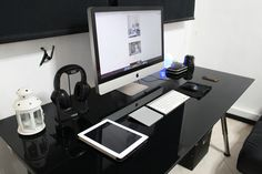 "Workspace submission by Shakila Hamdan.  iMac 27"" Razer Mouse Sound Blaster Omega 3D Tactic Seagate External Harddrive Derwent Electric Sharpener iPhone4 iPad4"